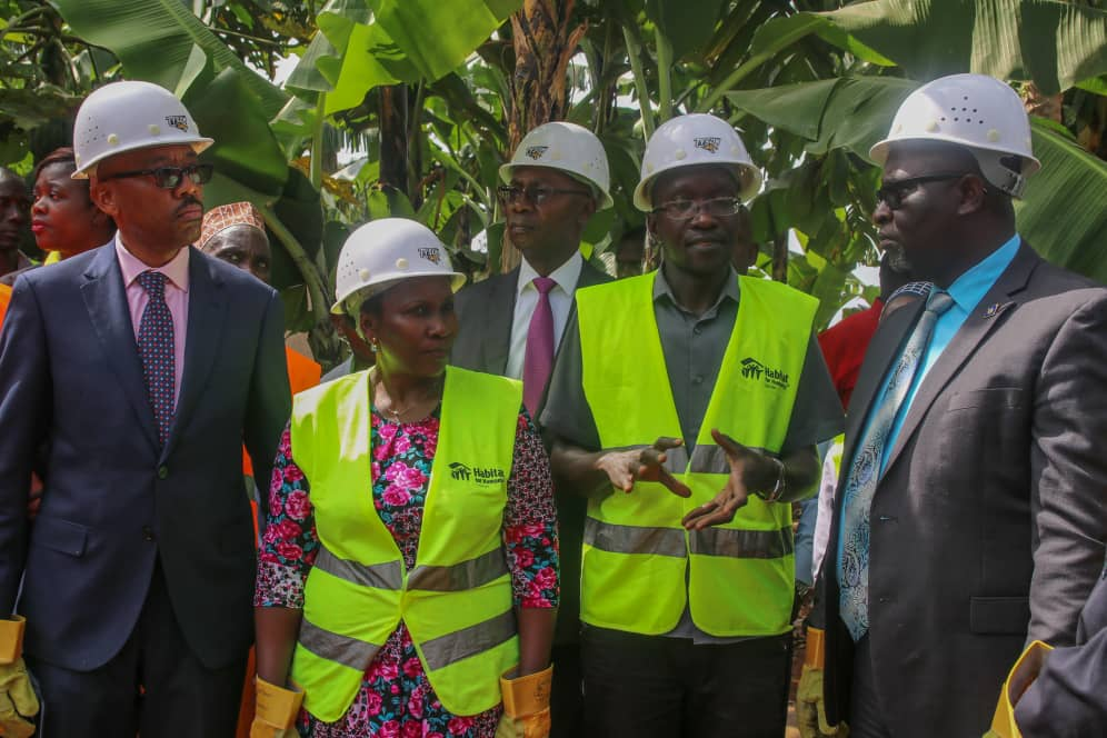 "Housing Finance Bank's Managing Director- Mr. Michael.K.Mugabi, Habitat For Humanity's National Director, Mrs. Leticia Kiyingi, 2nd Deputy Prime Minister Buganda Kingdom, Owekitiibwa Robert Waggwa Nsibirwa ahead of the ground breaking activity to launch the ""Decent Living Campaign""."