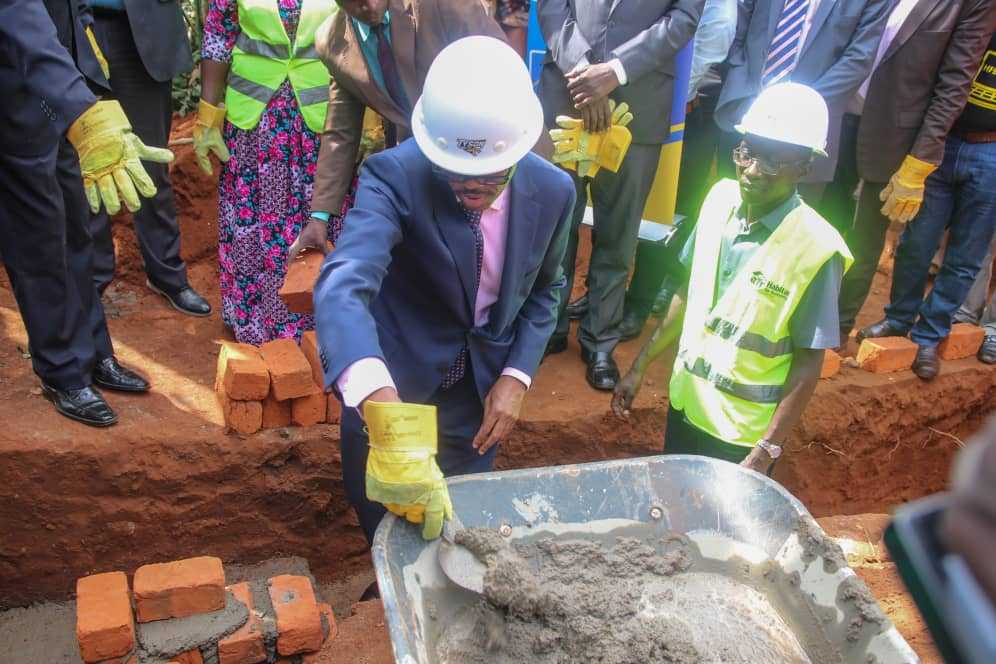 "The Managing Director, Housing Finance Bank- Mr.Michael.K.Mugabi laying the foundation to one of the houses during the ""Decent Living Campaign"" launch."